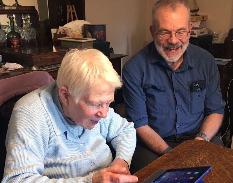 An AbilityNet ITCanHelp volunteer with a client